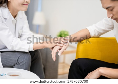 closeup of Asian female psychologist has a consultation with the male patient and give support to him Royalty-Free Stock Photo #1787080700