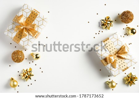 Happy New Year banner. Christmas design gold gifts box, golden balls, glitter confetti stars on white background. Decoration objects viewed from above. #1787173652