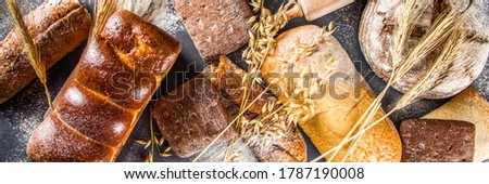 Various bread set. Many different wheat, grain and rye bread with ears of rye and wheat, flour and baker's tools on a white wooden background #1787190008