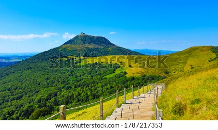 Puy de Dome- Auvergne in France- Volcanic landscape and blue sky Royalty-Free Stock Photo #1787217353