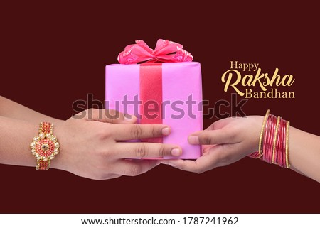 happy raksha bandhan (rakhi, rakshabandhan) concept. Indian brother giving gift to his sister