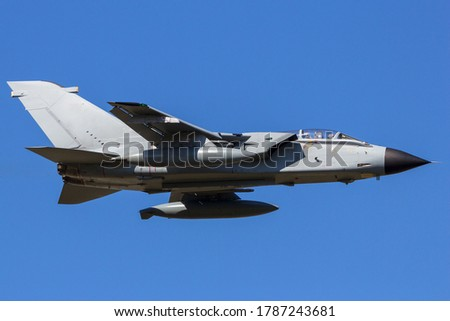 Air Force military fighter jet aircraft in flight on a blue sky #1787243681