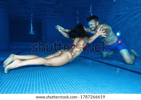 Couple in love underwater fun, underwater pics from the swimming pool