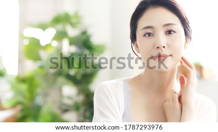 Beauty concept of an asian woman. Beauty salon. Skin care. Body care. Hair removal. Royalty-Free Stock Photo #1787293976