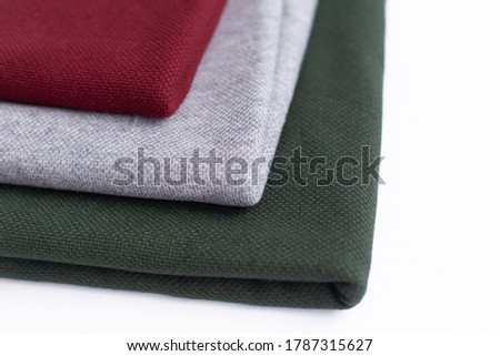 Angora fabric in three colors, fabric on a white background. three colors of fabric: Burgundy, gray, green #1787315627