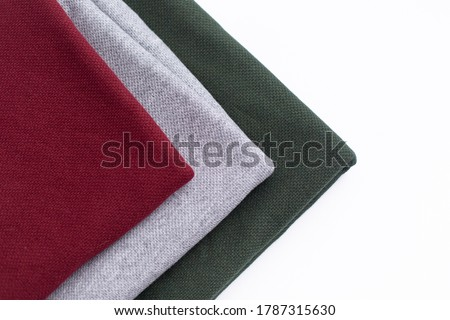 Angora fabric in three colors, fabric on a white background. three colors of fabric: Burgundy, gray, green #1787315630