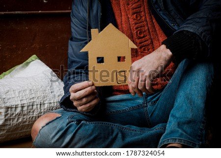A homeless person holds a sign , asks for work, and seeks help. The concept of poverty and homelessness Royalty-Free Stock Photo #1787324054