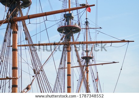 Sailing mast of ship. Sailing vessel main topgallant mast with crows nest. Old frigate warship Royalty-Free Stock Photo #1787348552