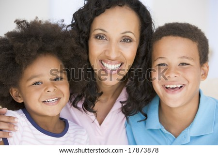 Woman and two young children smiling #17873878
