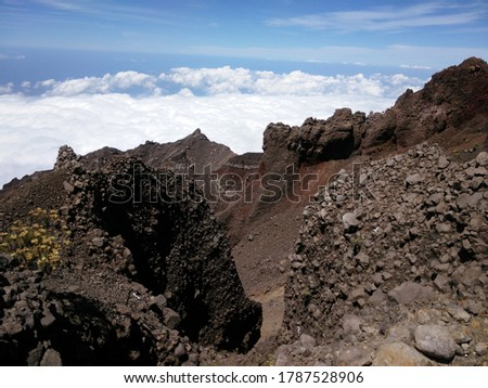 View of volcanic rock cliff and foggy on mountain at Mount Rinjani Summit Indonesia #1787528906