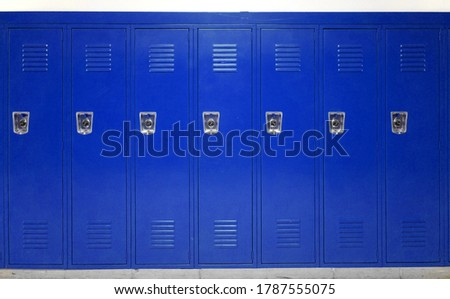 facade view of lockers in school gym painted in blue Royalty-Free Stock Photo #1787555075
