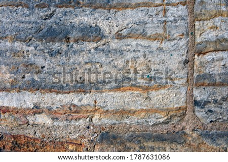 Close-up photo of the stone wall #1787631086
