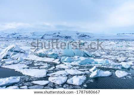 Aereal winter landscape view of Jokulsarlon lagoon, Iceland. Beautiful landscape picture of icelandic glacier lagoon bay in winter.