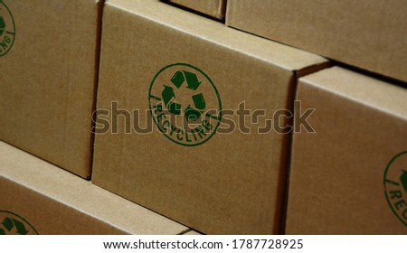 Recycling stamp printed on cardboard box. Recycle symbol, arrows, recyclable materials, environmental protection and earth safe concept.