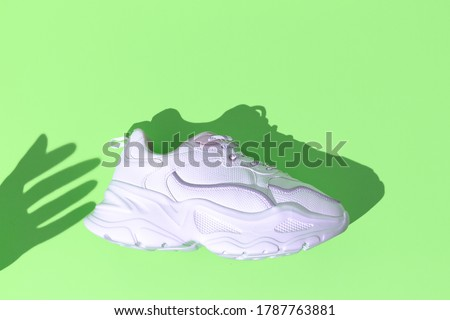Minimal still life art. Fashion sport shoes concept. Mint colours trends. Stylish white sneakers Royalty-Free Stock Photo #1787763881