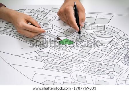 Cadastre Land Map. Cartographer Locating Building Plot Royalty-Free Stock Photo #1787769803