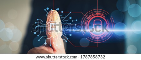 Cyber security and futuristic technology concept businessman using finger to touch fingerprint interface,to scan password,with technology icons and padlock,with artificial intelligence system or ai  Royalty-Free Stock Photo #1787858732