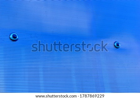 Blue striped transparent polycarbonate fabric on the construction #1787869229