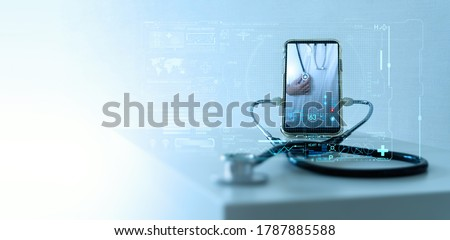 Tele medicine concept,Medical Doctor online communicating the patient on VR medical interface with Internet consultation technology Royalty-Free Stock Photo #1787885588