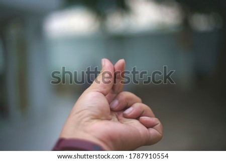 A marking finger heart  is a sign of  love.