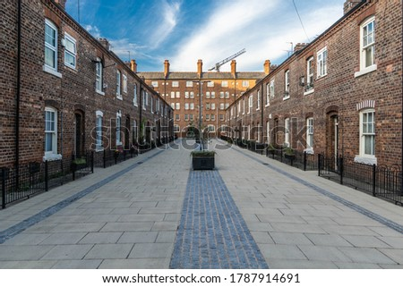 Quaint residential street in the fashionable neighbourhood of Ancoats in central Manchester. Anita Street with Victoria Square in the background. Royalty-Free Stock Photo #1787914691