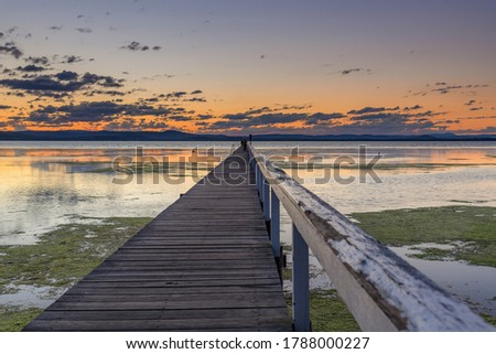 Sunset over Long Jetty on the Central Coast of NSW, Australia. Royalty-Free Stock Photo #1788000227