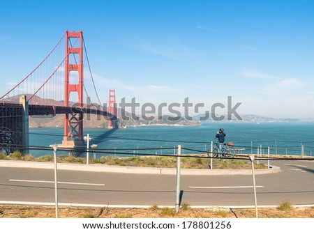 Golden Gate in San Francisco - Bicycle path and unidentified Biker taking a Picture