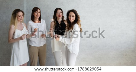 photo of a large large company of women having fun in the office, sparklers in their hands, glad that the Christmas holidays greet everyone dressed in formal clothes, jackets, shirts #1788029054