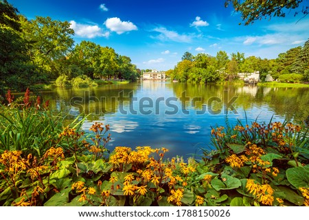 Lazienki Park - Baths Park or Royal Baths also rendered Royal Baths Park is the largest park in Warsaw, Poland. Beautiful lake with flowers. #1788150026
