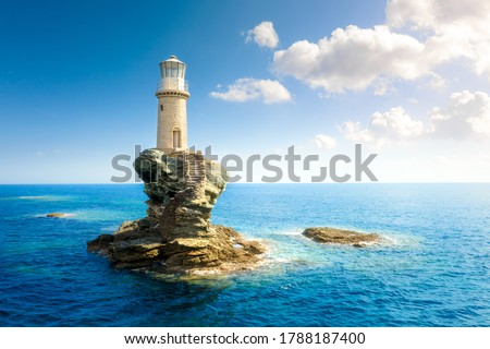 The beautiful Lighthouse Tourlitis of Chora in Andros island, Cyclades, Greece Royalty-Free Stock Photo #1788187400