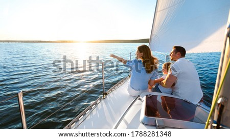 Sea Cruise. Family Sitting On Yacht Deck Sailing Across The Sea On Summer Vacation. Panorama, Copy Space Royalty-Free Stock Photo #1788281348