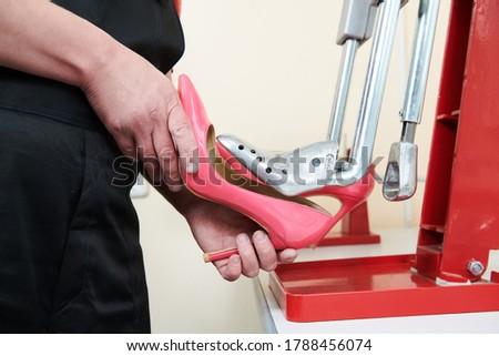 footwear stretching. high heels female shoes in repair shop