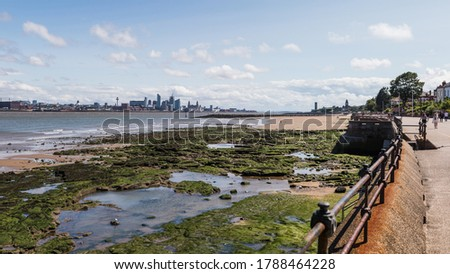 Liverpool skyline over the rockpools seen at low tide from the promenade at New Brighton in August 2020. Royalty-Free Stock Photo #1788464228
