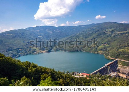 Water barrier dam and beautiful Perucac lake with clean blue water on river Drina in natural park Tara, Serbia. Landscape and travel concept #1788495143
