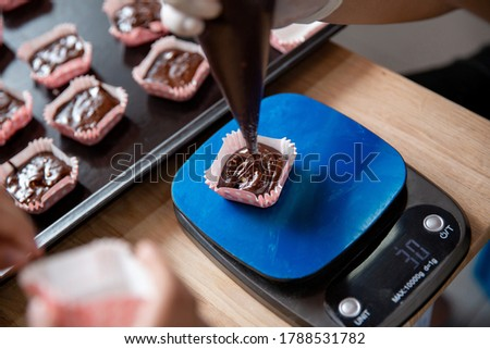 Making brownies with chocolate chunks - stock photo #1788531782