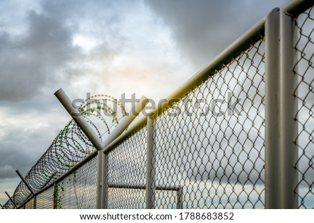 Prison security fence. Barbed wire security fence. Razor wire jail fence. Barrier border. Boundary security wall. Prison for arrest criminals or terrorists. Private area. Military zone concept.  #1788683852