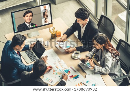 Video call group business people meeting on virtual workplace or remote office. Telework conference call using smart video technology to communicate colleague in professional corporate business. Royalty-Free Stock Photo #1788690932