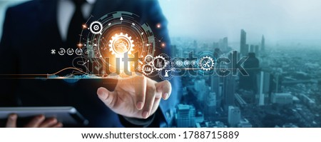 Industry 4.0, Businessman touching brain in cogwheel, Innovative and futuristic, Business process workflow development and optimisation of construction industrial on city background.  #1788715889