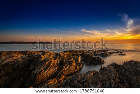 Coastal image in Woolacombe North Devon summer of 2020 At Sunset Royalty-Free Stock Photo #1788751040