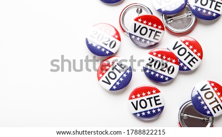 Presidential US election 2020, Red, white, and blue vote buttons isolated on white background, copy space Royalty-Free Stock Photo #1788822215