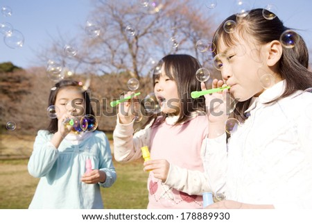 Girls and soap bubbles #178889930