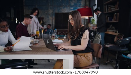 Zoom in portrait of beautiful young confident Caucasian business woman working, posing at modern loft office workplace. Royalty-Free Stock Photo #1788947990