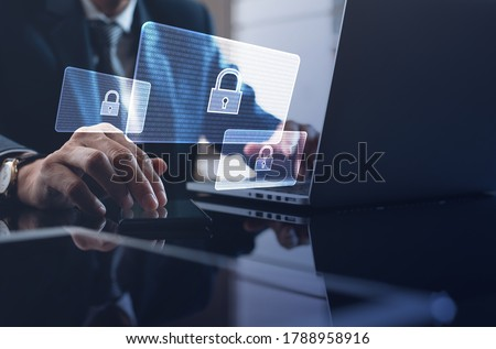 Cyber security, Business, technology, internet network, software development, digital data protection concept. Businessman working on laptop computer in office with pop up antivirus system Royalty-Free Stock Photo #1788958916