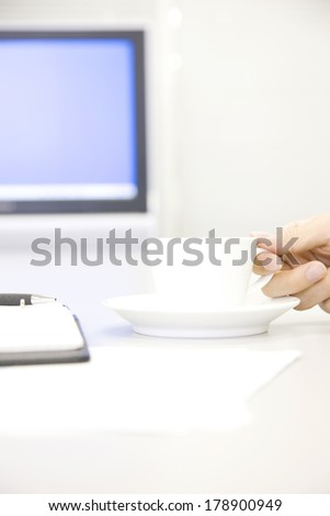 Hand of businessman with a cup of coffee #178900949