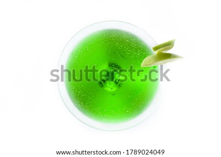 Green appletini cocktail in glass isolated on white background. Top view #1789024049
