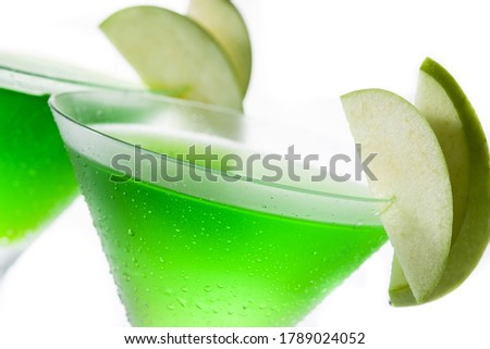 Green appletini cocktail in glass isolated on white background. #1789024052