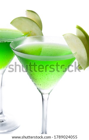 Green appletini cocktail in glass isolated on white background. #1789024055