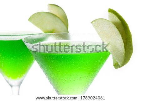 Green appletini cocktail in glass isolated on white background. #1789024061