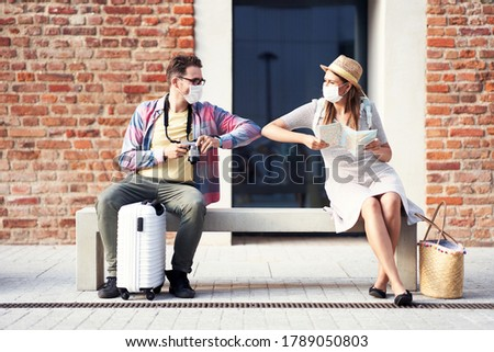 Adult tourists in masks sightseeing Gdansk Poland Royalty-Free Stock Photo #1789050803