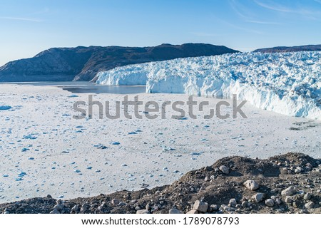 Climate Change Concept. Greenland Glacier heavily affected by Global Warming. Glacier front of Eqi glacier in West Greenland AKA Ilulissat and Jakobshavn Glacier. Produces many of Greenlands icebergs. #1789078793